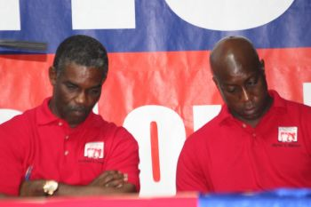 NDP At Large candidates Archibald C. Christian and Myron V. Walwyn at the meeting last evening. Photo: VINO