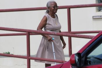 An aged woman leaving the Valerie O. Thomas Community Centre in Sea Cows Bay after she voted. Photo: VINO