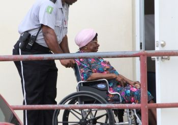 This woman being assisted getting into the polling station. Photo: VINO