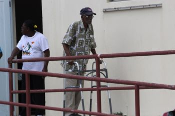 An elderly man leaving the polling station following casting his vote. Photo: VINO