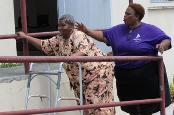 A woman being assisted to get to the polling booth today June 5, 2015 at the Valerie O. Thomas Community Centre in Sea Cows Bay. Photo: VINO