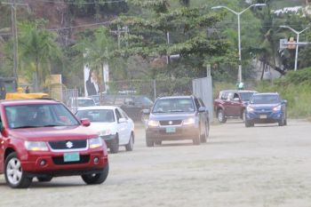 Vehicles streaming into Festival Grounds for the rally. Photo: VINO