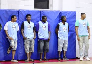 Some of the players of Splash Brothers at the roll call of teams on the opening night of the Hon Julian Fraser Save the Seed League at the Save the Seed Energy Center in Duff's Bottom, Tortola, on August 24, 2019. Photo: VINO