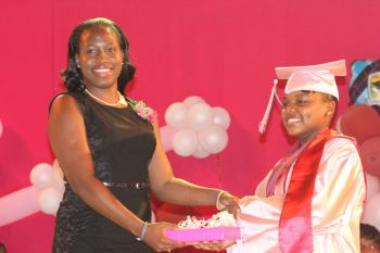 ASPS Valedictorian Kiymeiah Millington receives a special award from Mrs Vickie Andrew. Photo: VINO