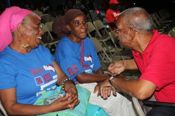 Dr The Honourable D. Orlando Smith (right) with Kishmet B. Daniel (centre) and another National Democratic Party (NDP) supporter. Photo: VINO
