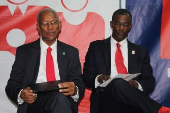 Dr The Honourable D. Orlando Smith (left) and fellow At Large candidate Hon Archibald C. Christian. Photo: VINO