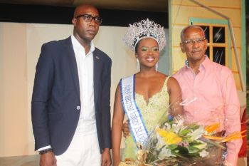 Premier Dr the Hon D. Orlando Smith (right) and Minister for Education and Culture Hon Myron V. Walwyn pose with contest-winner Jaynene Jno Lewis. Photo: VINO