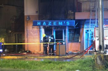 Firefighers about to enter the burnt Hazem's Shoe Store this morning, September 6, 2016. Photo: VINO