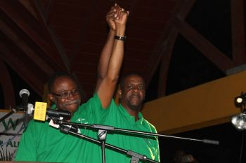 Senior Virgin Islands Party member Hon Andrew A. Fahie (R1) shows his full support of party chairman Hon Julian Fraser RA. Photo: VINO
