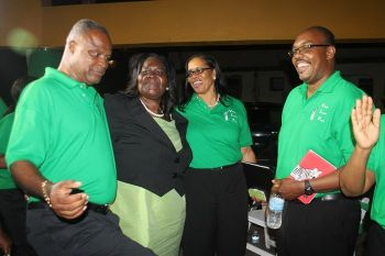 Oleanvine Pickering-Maynard interacts with fellow candidates following last night's, May 18, 2015 meeting. Photo: VINO
