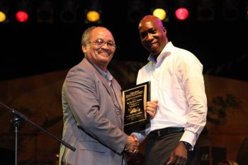 The Road Town Festival honouree was presented with a plaque from the Minister for Education and Culture, Hon. Myron V. Walwyn, for his outstanding contribution to the Emancipation Festival over the years and he called for a happy and safe Festival for everyone. Photo: VINO