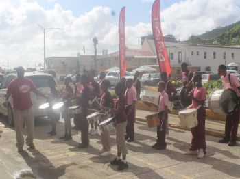 Digicel's adopted school, Althea Scatliffe Primary Striders Drum Corps playing at the reopening celebration of Digicel's flagship store. Photo: VINO