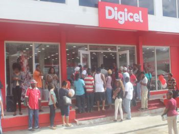 Customers flooded the doors of Digicel hours before the cutting of the ribbon to the new renovated store. Photo: VINO