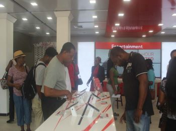 Digicel customers checking out the new interactive devices in the store. Photo: VINO