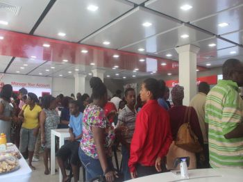 Digicel representative seen interacting with customers at the reopening of the flagship store on Waterfront Drive in Road Town. Photo: VINO