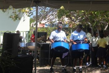 Instructor of the Claudia Creque Educational Centre steel band took the microphone and publicly recorded her disappointment in the band being left off the programme despite the fact that they were informed that they were to participate. Photo: VINO