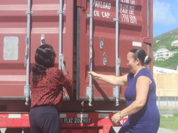 Mrs Judith Vanterpool, Vice President of One Mart Superstore and Sharlene S. Dabreo, Director of the Department of Disaster Management (DDM) opening a 20-foot container donated by One Mart Superstore which was filled with relief food items on November 22, 2017 at the Festival Grounds in Road Town. Photo: VINO