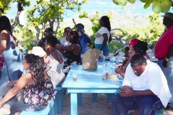 Chilling out at the Big Bamboo Restaurant and Bar in Loblolly Bay, Anegada. Photo: VINO