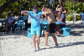 This tourist was not shy to express he was having tons of fun at the 5th Annual Anegada Lobster Festival. Photo: VINO