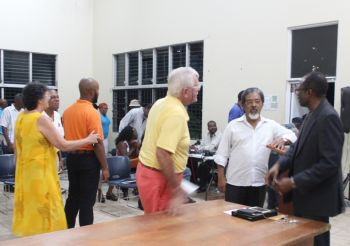 Hon Julian Fraser RA (right) interacting with former At Large Representative Mr Keith L. Flax (centre) and Third District resident Mr Roger Harris at the conclusion of the Public Meeting on October 20, 2016. Photo: VINO