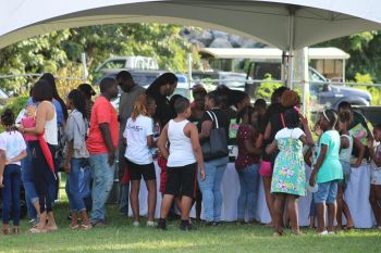 Children line up for a snack at the 13th Annual Back to School event in the First District at the Capoon's Bay Recreation Ground on September 8, 2019. Photo: VINO