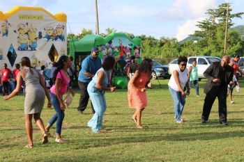 Premier and Minister of Finance Hon Andrew A. Fahie (R1) attempts the 'Electric Slide'. Photo: VINO