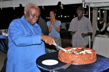 Governor Mapp on his 63 birthday given a cake. Photo: Mapp-Potter 2018