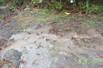 Roads appearing like mini-rivers during the heavy rains today. Photo: VINO