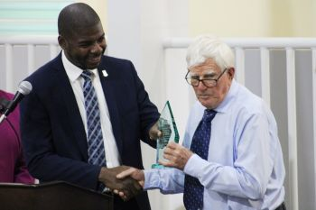 Benefactor of the Enis Adams Primary School, Mr Peter Haycraft, right, is presented with a plaque of gratitude from the Government of the Virgin Islands by Minister for Education, Culture, Youth Affairs, Fisheries and Agriculture, Dr The Hon Natalio D. Wheatley (R7). Photo: VINO