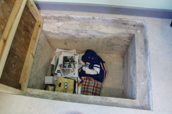 A time capsule, to reportedly be opened until a hundred years, has been placed in the floor of the Enis Adams Primary School. Photo: VINO