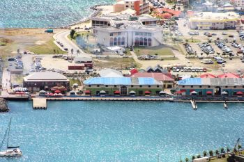 The Tortola Pier Park facility includes a 60ft wide, 1,312ft long pier that can berth ships up to a maximum tonnage of 180,000 GRT. The landside shopping center consists of over 60 stores, including retail, service providers, commercial spaces and office spaces. Photo: VINO