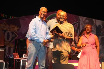 Mighty Strawn, who was the guest artiste for the Calypso competition, received a special award. He is a well known calypsonian being around the craft for many years. Photo: VINO