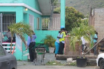 Relatives of a man found dead in a Purcell bar today console each other. The man believed to be in his early 40s was found dead by a staff and patrons of the establishment just before noon today Monday March 17, 2014. Photo: VINO
