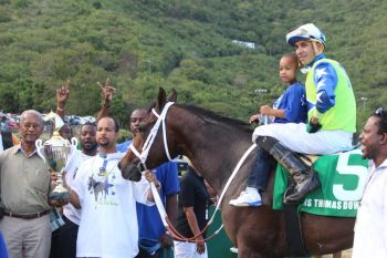Horse owner Alex V. Lake (with trophy) expressed that he is extremely confident ahead of horse races to be held at the Randall 'Doc' James racetrack in St Croix this Sunday, February 16, 2014. Photo: VINO