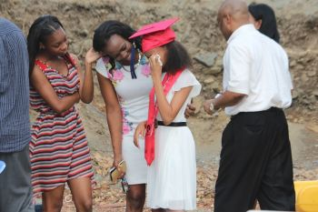 And then it struck home for Valedictorian Kaeli A. Alphonso that she was really leaving Pelican Gate School! Photo: VINO