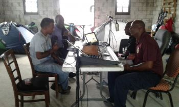 Flow Head of Commercial, Ravindra Maywahlall is pictured during an interview with VG Rock 88.5 FM as he provided an update on Missions Day activities undertaken in Virgin Gorda, as well as the collaborative partnership with Rotary International with the rebuilding works to be undertaken at the Bregado Flax Educational Centre Secondary Division. Photo: Flow