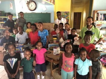 "Valley Day School students in a photo opportunity with Mr World BVI (back) and Mr Allington O. Creque aka ""Gumption"" (far right). Photo: VINO"