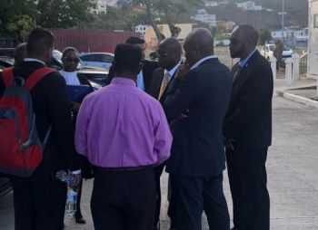 Lawyers for the HoA Speaker, Hon Julian Willock huddled in a conversation. Photo: Team of Reporters