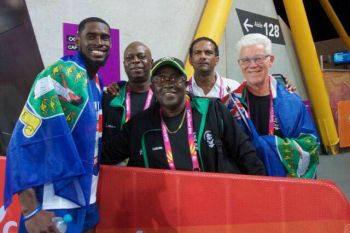 Virgin Islands gold medallist at the Commonwealth Games 2018 in Australia, Kyron A. McMaster, left, takes a photo with a part of the Virgin Islands contingent that includes President of the BVI Olympic Committee Mr Ephraim Penn, centre, and Deputy Premier and Minister for Natural Resources and Labour Dr The Honourable Kedrick D. Pickering (R7), 2nd from right. Photo: Provided