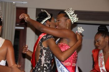 Miss BVI 2016/2016 Erika R. Creque embraces Miss World BVI Kadia K. Turnbull. Photo: VINO