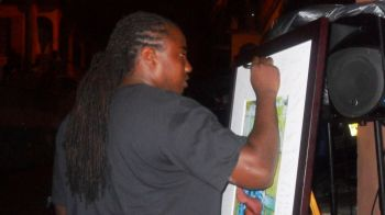 Survivor of the accident, Mustafa Claxton, signs a memorial in Todman's honour. Photo: Facebook