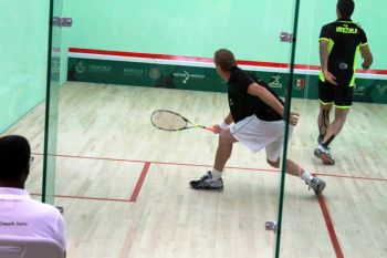 The Squash tournament kicked off on Sunday November 23, 2014 with Round of 32 when Michael Adamson (left) played against Ricardo Teran of Venezuela in the Leyes de Reforma Venue in the city of Boca Del Rio. Adamson lost in 4 sets 11-5, 11-4, 5-11 and 11-5. Photo: Provided