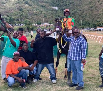 The feature race with a purse of $8000 was won by Tortola's 'Moon Light Bandit' and coming in second was 'Giant Valley' also from Tortola. Both horses are owned by Lesmore Smith of Top Priority Racing Stables. Photo: Team of Reporters