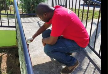 Minister for Education, Culture, Youth Affairs, Fisheries and Agriculture, Dr The Honourable Natalio D. Wheatley (R7) painting the outside rails of the Nurse Iris Penn-Smith Clinic in Parham Town on December 14, 2019. Photo: Facebook