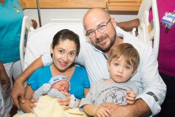 Ecstatic parents Marlourgui Marcias- Downing, left, and Thor Downing with their children Roger and newborn Jose, left. Photo: BVIHSA