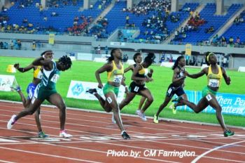 Nelda Huggins collected a Silver of her own in the U-17 Girls 100m final, sprinting to an 11.81 seconds personal best to finish third in her heat, advancing to the final, where she snatched silver in 11.94 seconds. Photo: Cleave Farrington