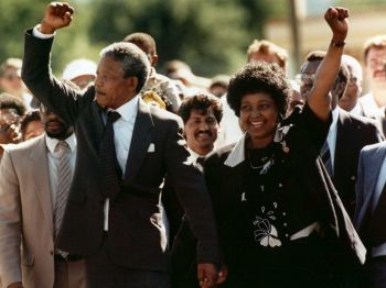 Nelson Mandela and wife Winnie, walking hand in hand, raise clenched fists upon his release from Victor prison, Cape Town, Sunday, February 11, 1990. Photo: Business Insider