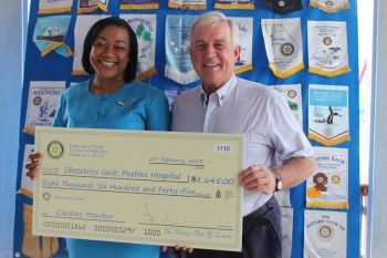 Ms. Jacinth Hannibal of Peebles Hospital received the cheque of $8,645.00 from President of the Rotary club of Tortola, Mr. Samuel Welch. Photo:VINO