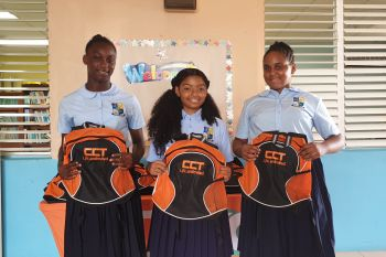 Students of the Bregado Flax Educational Center with their backpacks of school supplies, compliments of CCT. Photo: Provided