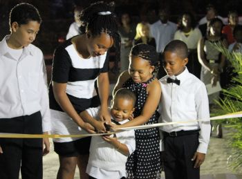 Grandchildren of Mrs Patsy Lake seen cutting the ribbon during the dedication ceremony for Pasea Place. Photo:VINO